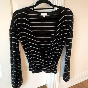 Twist front low V-neck sweater